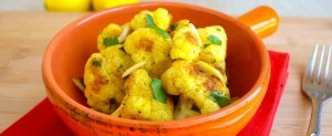 Sunkist® Pan-Roasted Lemon-Curry Cauliflower with Almonds and Golden Raisins