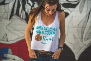 "A woman models a Celiac Cutie shirt that reads, ""When life gives you a cookie- run!"""