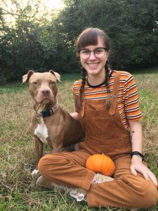 Pippi, a pitbull mix, sits with her owner Nicole.